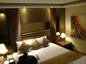 The Nova Gold Hotel Pattaya bed corner