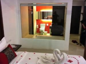 al.fres.co Phuket Hotel bed and see through toilet view